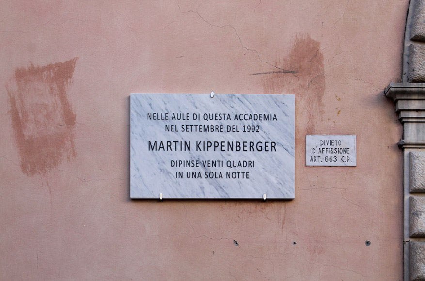 Francesco Fossati, Fake History [KIPPENBERGER], 2015, installation view, historic center of Carrara IT, Carrara Marble plaque, 80 x 50 x 3 cm IN THE CLASSROOMS OF THIS ACADEMY, IN SEPTEMBER 1992, MARTIN KIPPENBERGER PRODUCED 20 PAINTINGS IN ONE NIGHT Nelle aule di questa accademia, nel settembre del 1992, Martin Kippenberger dipinse venti quadri in una sola notte