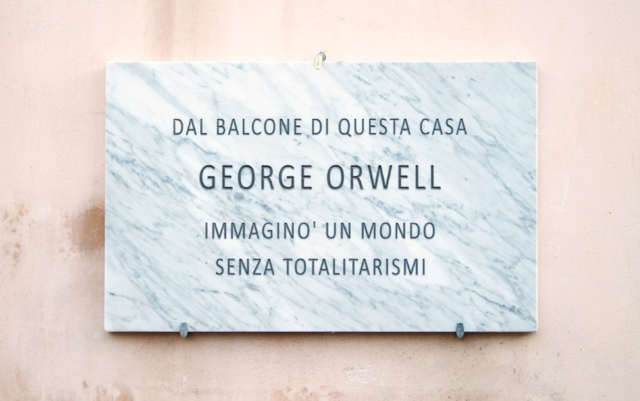 Francesco Fossati, Fake History [ORWELL], 2015, installation view, historic center of Carrara IT, Carrara Marble plaque, 80 x 50 x 3 cm FROM THE BALCONY OF THIS HOUSE GEORGE ORWELL IMAGINED A WORLD WITHOUT TOTALITARIANISM Dal balcone di questa casa George Orwell immaginò un mondo senza totalitarismi