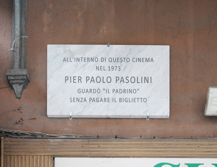 "Francesco Fossati, Fake History [PASOLINI], 2015, installation view, historic center of Carrara IT, Carrara Marble plaque, 80 x 50 x 3 cm INSIDE THIS CINEMA IN 1973 PIER PAOLO PASOLINI HAS WATCHED ""THE GODFATHER"" WITHOUT PAY THE TICKET In questo cinema nel 1973 Pier Paolo Pasolini guardò Il Padrino senza pagare il biglietto"