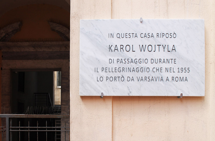 Francesco Fossati, Fake History [WOJTYLA], 2015, installation view, historic center of Carrara IT, Carrara Marble plaque, 80 x 50 x 3 cm IN THIS HOUSE KAROL WOJTYLA RESTED DURING THE PILGRIMAGE WHICH IN 1955 TOOK HIM FROM WARSAW TO ROME In questa casa riposò Karol Wojtyla di passaggio durante il pellegrinaggio che nel 1955 lo portò da Varsavia a Roma